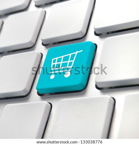Shopping cart computer key, on-line internet buying concept. - stock photo