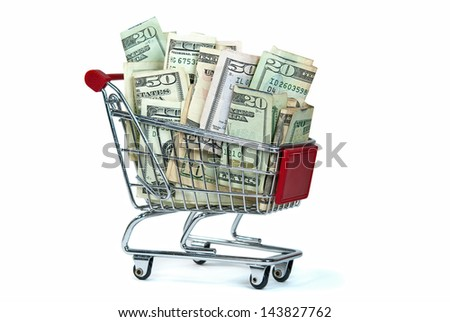 shopping cart filled with cash isolated on white