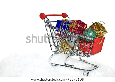 shopping cart filled with Christmas ornaments and gifts
