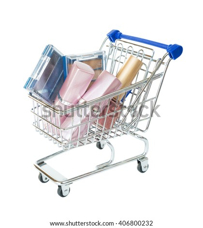 Shopping cart filled with cosmetics isolated on white background