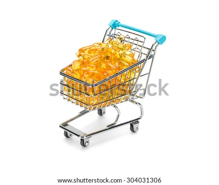 Shopping cart filled with yellow omega 3 fatty acids capsules on pure white background. Healthy shopping and lifestyle concept. - stock photo