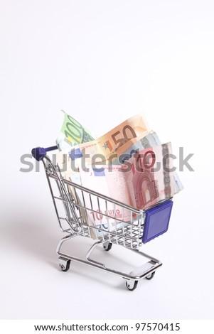 Shopping cart full of money isolated - stock photo