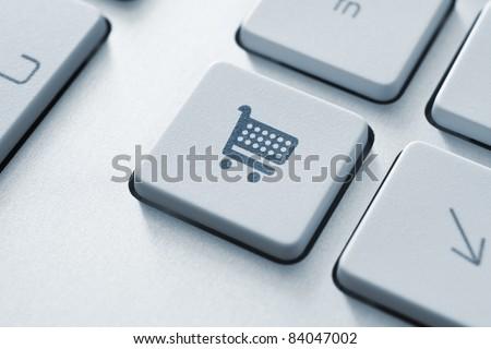 Shopping cart icon on keyboard key. Toned Image. - stock photo