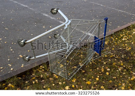 Shopping cart in a store parking lot - stock photo