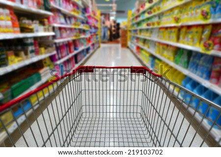 Shopping cart in supermarket background - stock photo