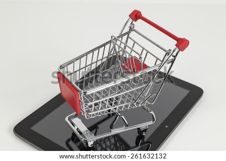 shopping cart on a tablet computer - stock photo
