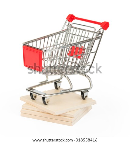 Shopping cart on paving tiles on isolated white background, side view