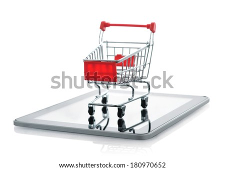 Shopping cart on tablet pc isolated on white background - stock photo