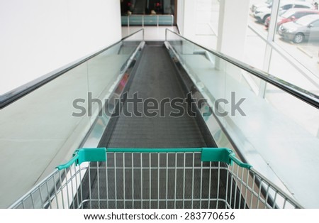 shopping cart on the elevator in supermarket - stock photo