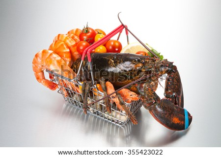 Shopping Cart seafood, vegetables. - stock photo