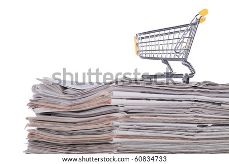 Shopping cart to buy the latest news (selective focus) - stock photo