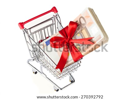 Shopping cart with banknotes - stock photo
