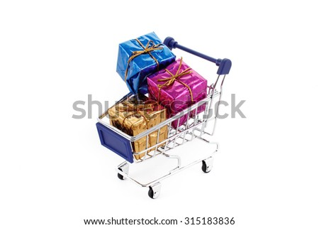 Shopping cart with colorful gift boxes isolated on white background,stock image