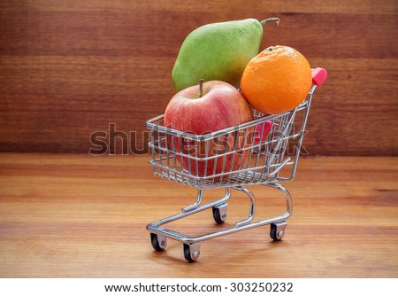 Shopping Cart with Fresh Fruit  - stock photo
