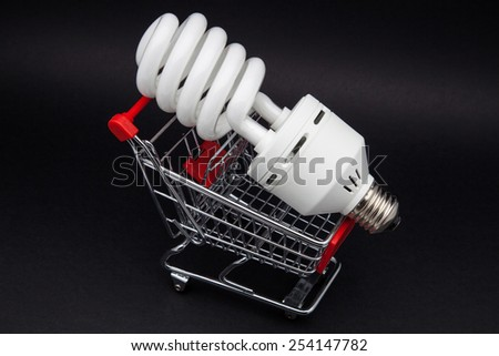 shopping cart with light on a black background - stock photo