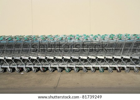 Shopping carts in a row - stock photo