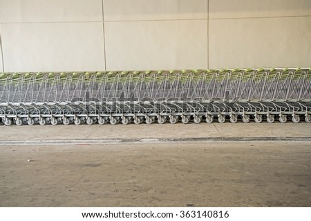 Shopping carts in a shopping mall basement parking - Shopping carts on a parking lot  - stock photo