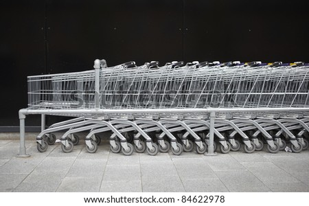 Shopping Carts next to a supermarket - stock photo