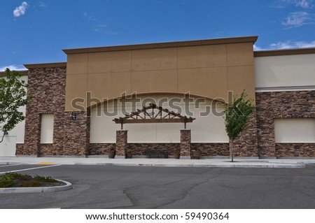 Shopping Center Facade with Blue Sky - stock photo