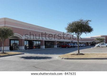 Shopping center with all logos and signs removed - stock photo
