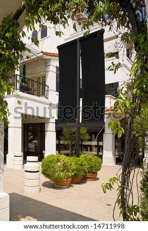 Shopping center with black blank sign age for customization - stock photo