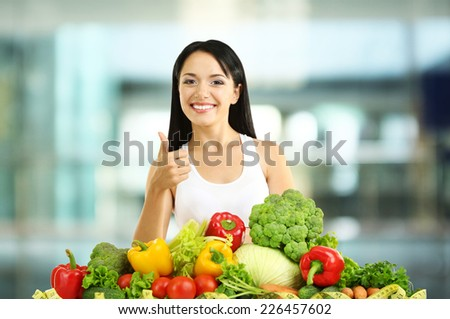 Shopping concept. Girl with vegetables on shop background - stock photo