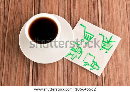 Shopping concept on a napkin and cup of coffee - stock photo