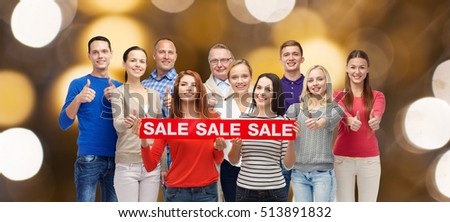 shopping, family, generation and people concept - group of happy men and women showing thumbs up and sale sign over holidays lights background