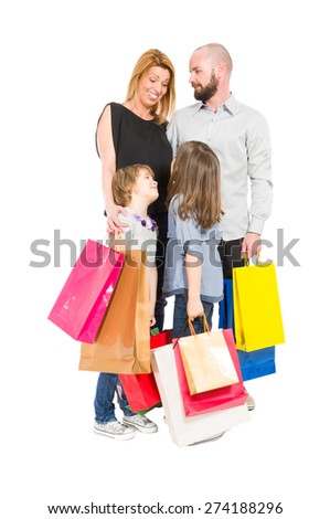 Shopping family of husband, wife and two young daughters - stock photo