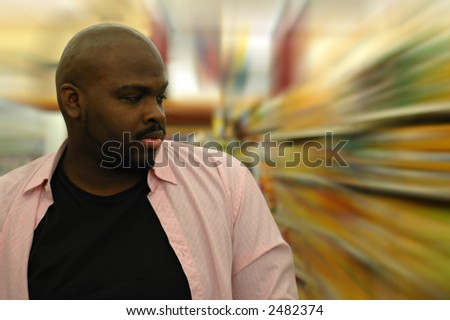 Shopping for groceries.  Confused shopper. - stock photo