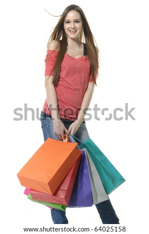 shopping girl in jeans with colorful bag in the studio - stock photo