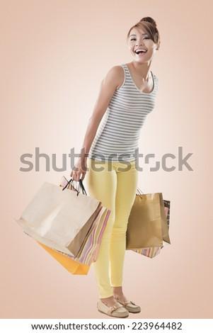 Shopping girl of Asian, full length portrait isolated on white  - stock photo