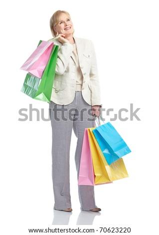 Shopping happy  elderly woman. Isolated over white background - stock photo