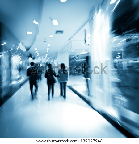 shopping in mall, blur motion - stock photo