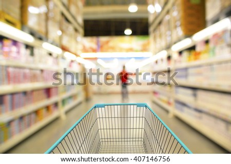 Shopping in supermarket shopping cart view - stock photo