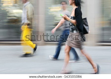 shopping in the city in motion blur style - stock photo