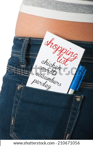Shopping list concept using a paper card on the back pocket of a woman's blue jeans - stock photo
