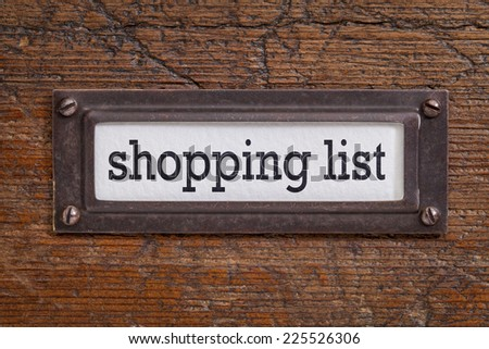 shopping list - - file cabinet label, bronze holder against grunge and scratched wood