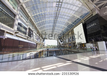 Shopping mall center and Modern building in Singapore Singapore - October 23, 2014: Outlet in Marina Bay Sands shopping center and Modern building around Marina Bay - stock photo