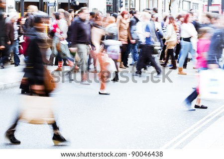 shopping people walking on the pedestrian crossing - stock photo