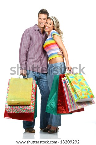 Shopping  smile couple. Isolated over white background
