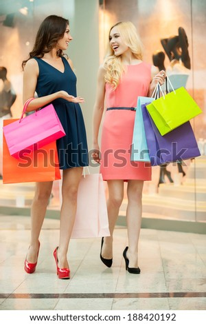 Shopping spree. Beautiful young women shopping in a clothing store