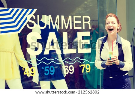 Shopping time sale event. Beautiful young woman standing outside in front of store display window, summer price reduction sign excited laughing. Positive human emotion face expression. Summer spree - stock photo