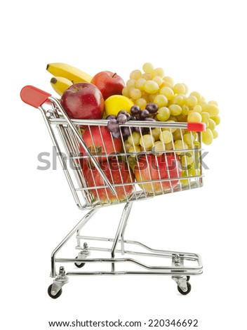 Shopping trolley full of fresh fruits isolated on a white background - stock photo