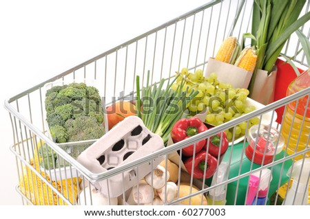 Shopping trolley full of grocery - a series of SHOPPING TROLLEY images. - stock photo