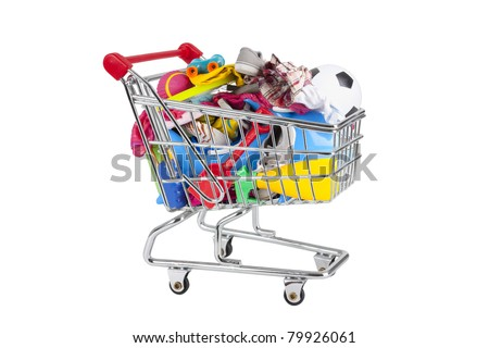 shopping trolley full of holiday things like swimwear, buckets, spades, toys. - stock photo