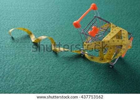 Shopping trolley. Shopping cart. Shopping trolley on multi collored background. Free space for your informations - stock photo