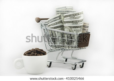 Shopping trolley with dollars and a cup of roasted coffee beans for business concept isolated on a white background