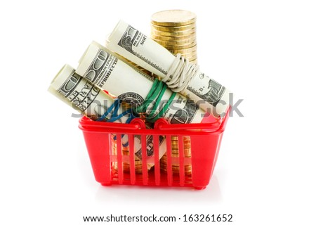 shopping trolley with dollars and coins, isolated on white - stock photo