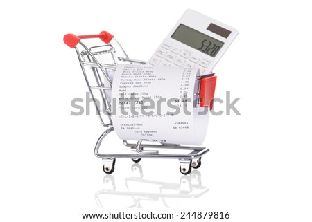 Shopping Trolley With Receipts And Calculator Over White Background - stock photo